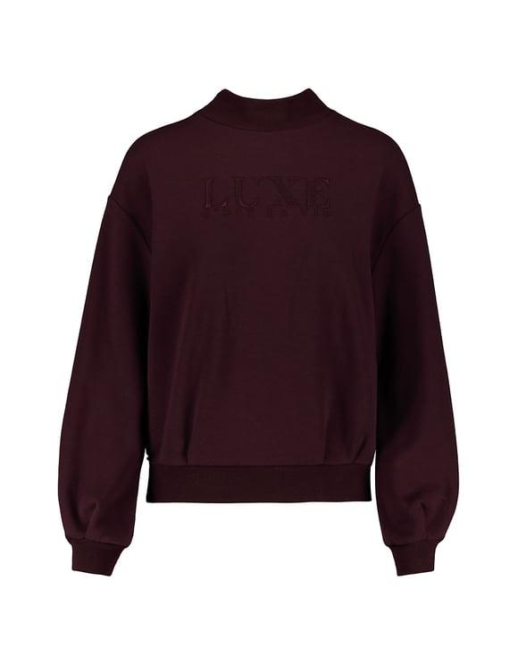 Bordeauxrotes Sweatshirt mit Stickereien