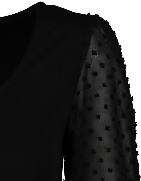 Czarny top z balonowymi rękawami z siateczki