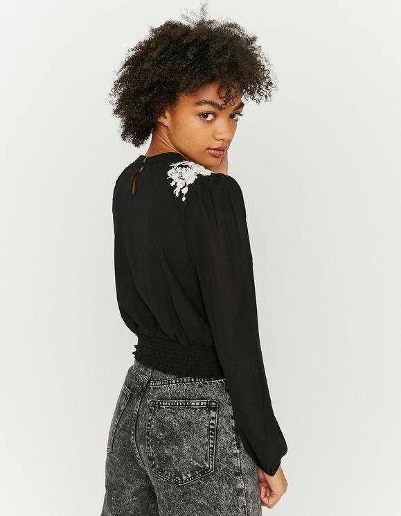 Schwarze Bluse mit Stickereien