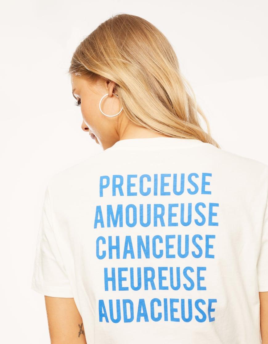 T-shirt Bianca con Angelo e Slogan